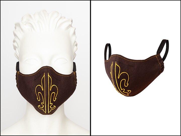 Mundmaske aus brauner Baumwolle mit Stickerei und einem Gummiband hinter den Ohren