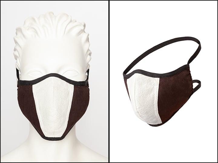 Mundmaske aus braun-weisser Baumwolle und Gummibändern für Kopf und Nacken